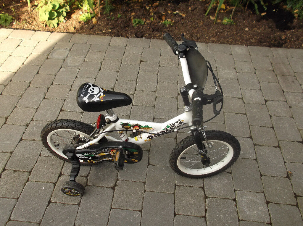 Childrens bicycle fitted with removable stablisers