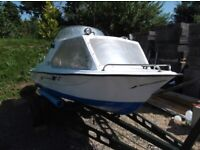 Boat, Trailer and Johnson 25hp Outboard Engine. £1,695