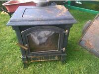 Oil burn and coal effect stove