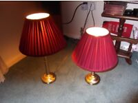 pair of brass coloured table lamps with shades