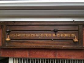 Vintage wooden snooker scorer hangs