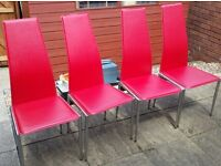 4 dining chairs. Red leather on chrome frame. In very good condition.
