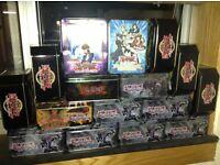 Yugioh tin with 200 cards each x4