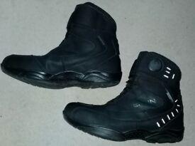 Short waterproof motorbike boots.