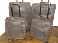 4 good size suitcases