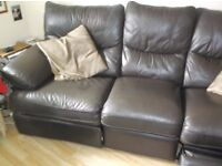 Reclining sofa in brown leather