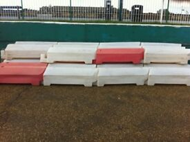 Red and white road barriers