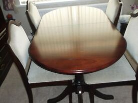 McDonagh Mahogany Extendable Dining Room Table with 6 Chairs.