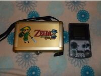 Nintendo clear Gameboy Color with a Zelda metal hard carry case.