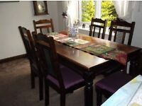 Dark wood solid table and 6 dining chairs