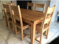 Lovely solid oak dining table & 6 solid oak chairs