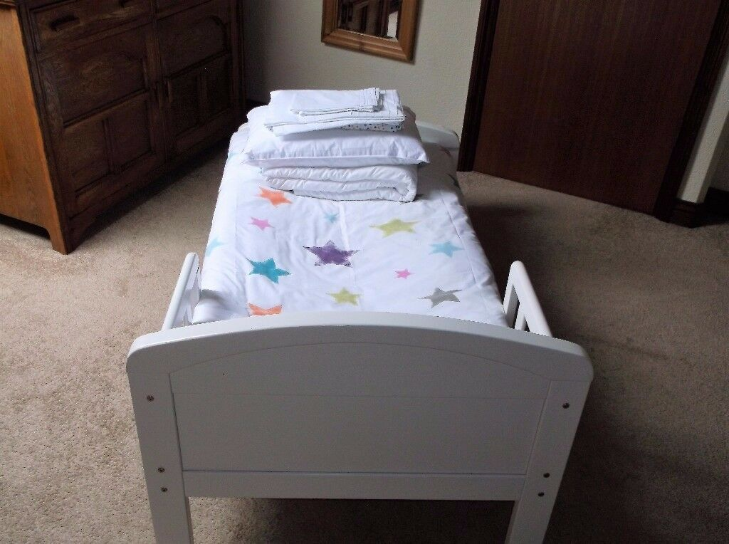 A juniour bed with two sets of linen. little used