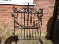 A Wrought Iron Black Garden Gate