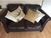Brown leather sofas plus storage footstool