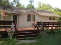 All year cottage in a quiet treed lot for matured people