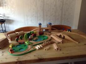 Childrens wooden train track and vehicles.