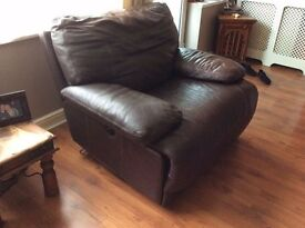 .Italian brown leather electric recliner chair was £1000 new very thick leather