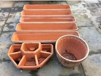 Selection of terracotta coloured plastic planters