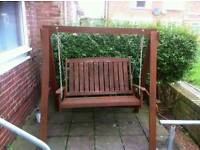 Brown wooden bench swing