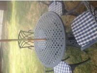 CAST ALUMINIUM GARDEN TABLE AND 4 CHAIRS PLUS BASE PARASOL AND CUSHIONS
