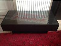 Glass and dark wooden coffee table
