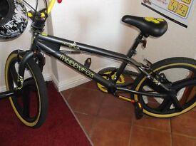 Boys B M X muddyfox bike green and black 20ins