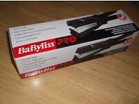Babyliss-Pro Professional Straightening Iron.