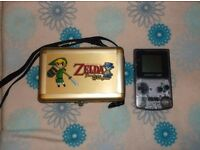 Nintendo clear Gameboy Color with a Zelda metal hard carry case to keep it safe.