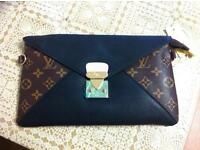 Louis Vuitton clutch with long chain