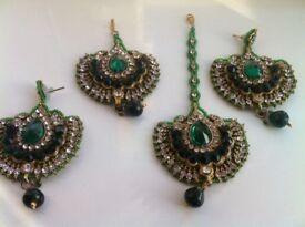 Beautiful green and gold beaded earrings,tikka and jhumar set
