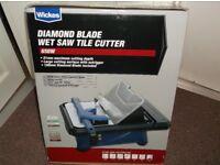 Diamond blade wet saw tile cutter.