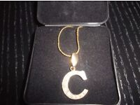 Gold zirconia 'C' encrusted necklace