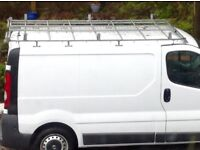 Roof rack for SWB Nissan Primastar includes up stands for ladders and a central walkway