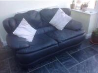 2 x Navy leather sofas