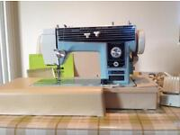 Janome New Home Sewing Machine, Model 580 complete with Carrying Case