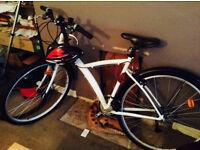 B'TWIN Hybrid bike with locks and safety gear