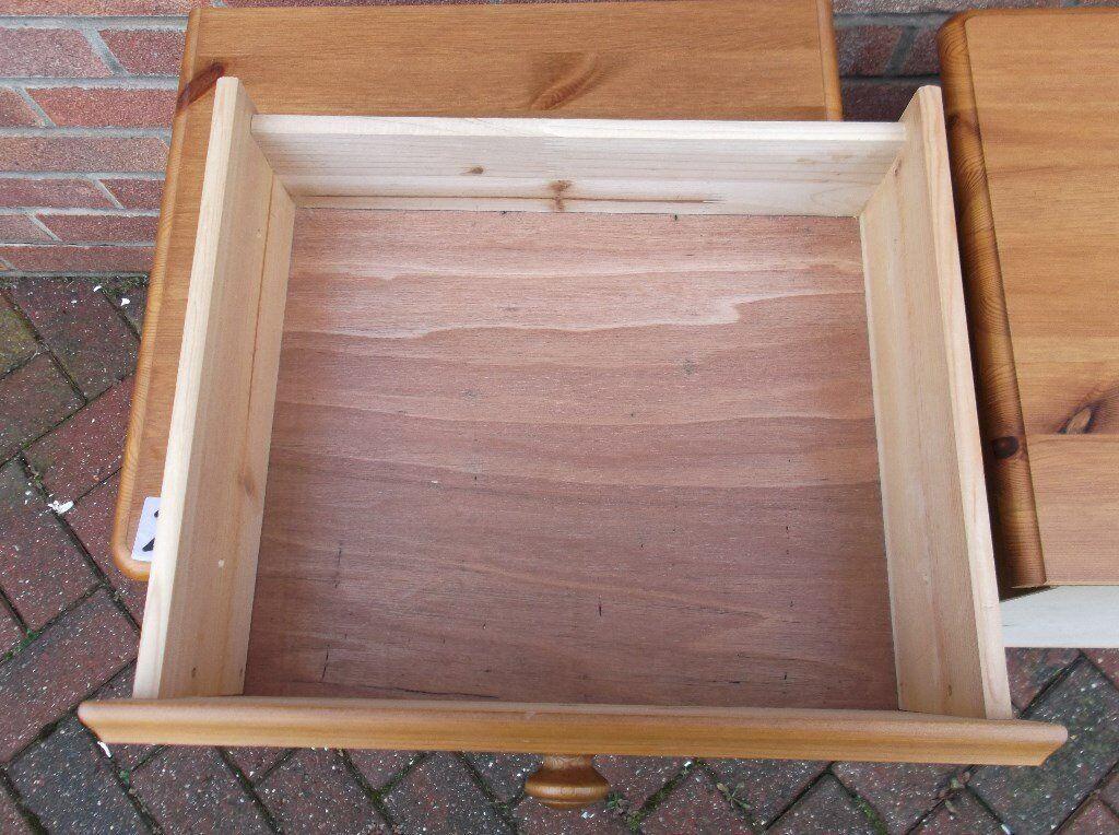 Solid pine bedside cabinets .