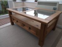 LARGE WOODEN COFFEE TABLE WITH 2 GLASS PANELS.