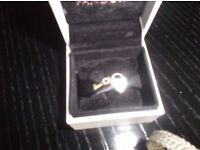 Pandora silver heart lock and gold key charm
