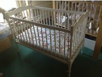 charming white vintage (50s?) cot.