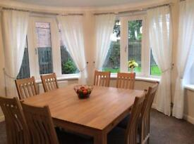Oak square dining table and chairs.