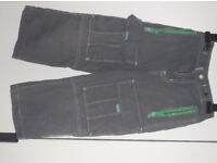 Mini-Boden boy's cargo trousers. Age 5 years. Grey with green zips/ tags and adjustable waist.