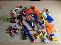 13 PIECE NERF GUN ARSENAL WITH ADD ONS , BULLETS AND ACCESSORIES