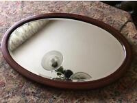 Gorgeous oval vintage wooden framed bevel edged mirror.