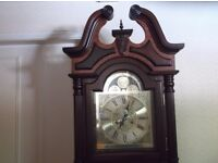 mahogany long case grandfather clock hand wind 31 day chiming ornated fluted column turned serviced