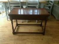 Oak hardwood coffee/occasional table which swivels to reveal inlaid chequer board