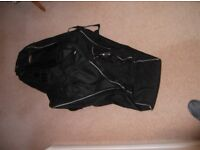 Travel Bag for golf clubs holds a full set of clubs plus shoes etc.