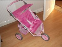 BRAND NEW THREE WHEEL DOLL' S DOUBLE BUGGY IN PINK