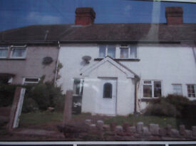 CHEPSTOW. 2double bed mid terraced house with front and rear garden, ch,double glazed, parking.