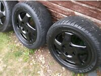 SET 4 ,REFURBED BLACK, STUNNING LOOKING,4 X 114/114.3 PCD ALLOY WHEELS C/W CENTRES C/W 205/55/15 s